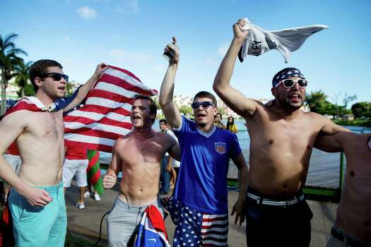 Soccer fans of the United States celebrate before a World Cup round of 16 between the U.S. and Belgium outside the Arena Fonte Nova stadium in Salvador, Brazil, Tuesday, July 1, 2014. (AP Photo/Rodrigo Abd) Photo: Rodrigo Abd, Associated Press / AP