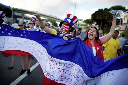 Soccer fans of the United States celebrate before a World Cup round of 16 match between the U.S. and Belgium outside the Arena Fonte Nova stadium in Salvador, Brazil, Tuesday, July 1, 2014. (AP Photo/Rodrigo Abd) Photo: Rodrigo Abd, Associated Press / AP
