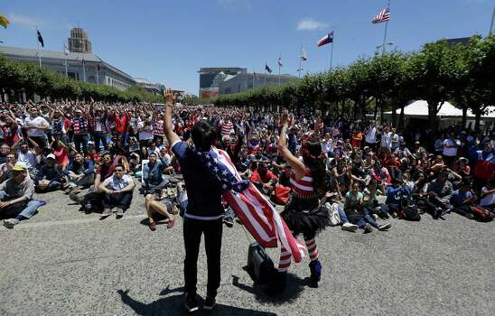 United States fans watch the World Cup round of 16 soccer match between the United States and Belgium at a public viewing party in San Francisco, Tuesday, July 1, 2014. (AP Photo/Jeff Chiu) Photo: Jeff Chiu, Associated Press / AP