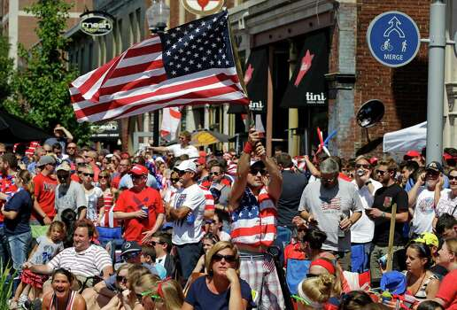 United States fans cheer during the World Cup soccer match between the United States and Belgium at a viewing party in Indianapolis, Tuesday, July 1, 2014. (AP Photo/Michael Conroy) Photo: Michael Conroy, Associated Press / AP
