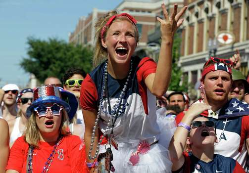Stacey Klene, center, of Indianapolis, reacts to the lack of a call during the World Cup soccer match between the United States and Belgium at a viewing party in Indianapolis, Tuesday, July 1, 2014. (AP Photo/Michael Conroy) Photo: Michael Conroy, Associated Press / AP
