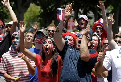 United States fans cheer as they watch the World Cup round of 16 soccer match between the United States and Belgium at a public viewing party in San Francisco, Tuesday, July 1, 2014. (AP Photo/Jeff Chiu) Photo: Jeff Chiu, Associated Press / AP