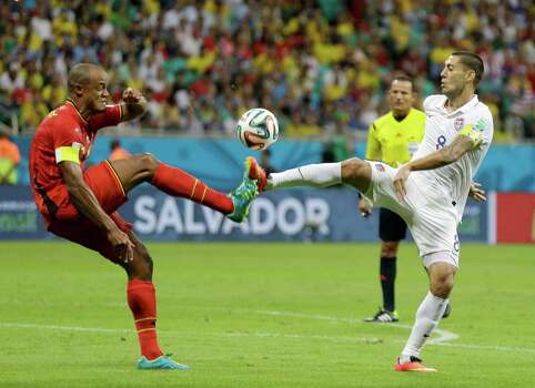 Belgium's Vincent Kompany tries to clear the ball with United States' Clint Dempsey during the World Cup round of 16 soccer match between Belgium and the USA at the Arena Fonte Nova in Salvador, Brazil, Tuesday, July 1, 2014. (AP Photo/Natacha Pisarenko) Photo: Natacha Pisarenko, Associated Press / AP