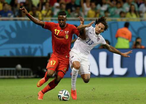 Belgium's Divock Origi, left, is challenged by United States' Jermaine Jones during the World Cup round of 16 soccer match between Belgium and the USA at the Arena Fonte Nova in Salvador, Brazil, Tuesday, July 1, 2014. (AP Photo/Matt Dunham) Photo: Matt Dunham, Associated Press / AP