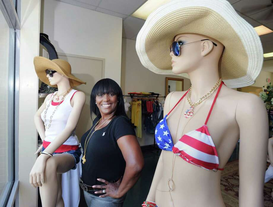 Claudette Rothman, owner of Greenwich Diva, with a July 4th-themed bikini on a mannequin in her relocated store at 177 Sound Beach Ave., Old Greenwich, Conn., Tuesday, July 1, 2014. Photo: Bob Luckey / Greenwich Time