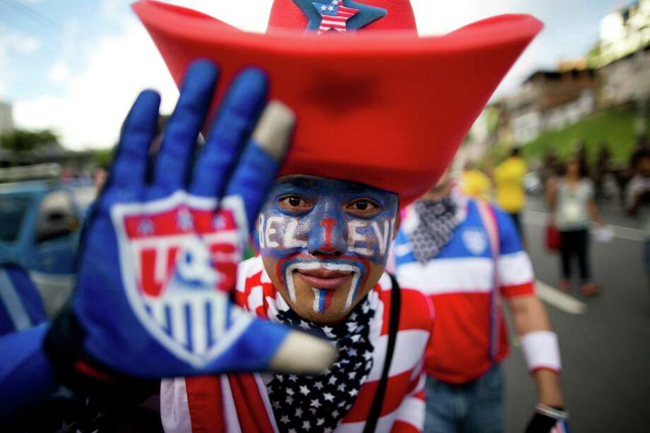 A soccer fan of the United States poses for the picture before World Cup round of 16 match between the U.S. and Belgium outside the Arena Fonte Nova stadium in Salvador, Brazil, Tuesday, July 1, 2014. (AP Photo/Rodrigo Abd) Photo: Rodrigo Abd, Associated Press / AP