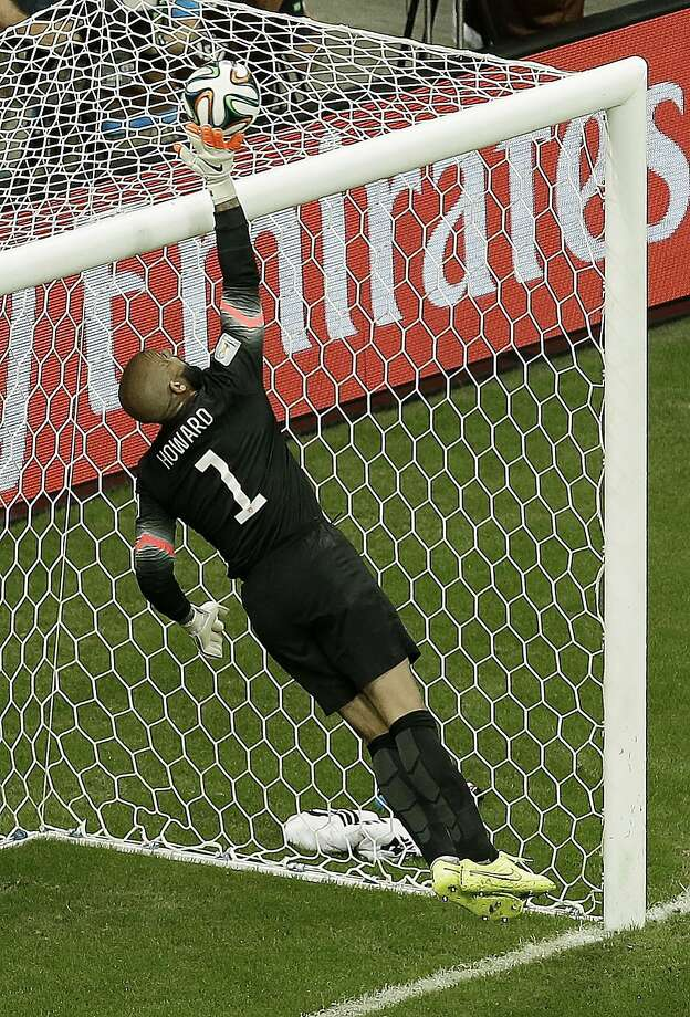 United States' goalkeeper Tim Howard deflects the ball over the crossbar during the World Cup round of 16 soccer match between Belgium and the USA at the Arena Fonte Nova in Salvador, Brazil, Tuesday, July 1, 2014. (AP Photo/Themba Hadebe) Photo: Themba Hadebe, Associated Press