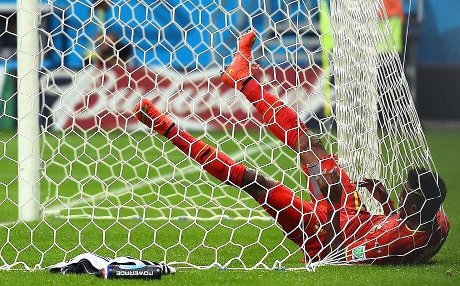 SALVADOR, BRAZIL - JULY 01:  Divock Origi of Belgium falls into the net after a missed chance during the 2014 FIFA World Cup Brazil Round of 16 match between Belgium and the United States at Arena Fonte Nova on July 1, 2014 in Salvador, Brazil.  (Photo by Laurence Griffiths/Getty Images) Photo: Laurence Griffiths, Getty Images