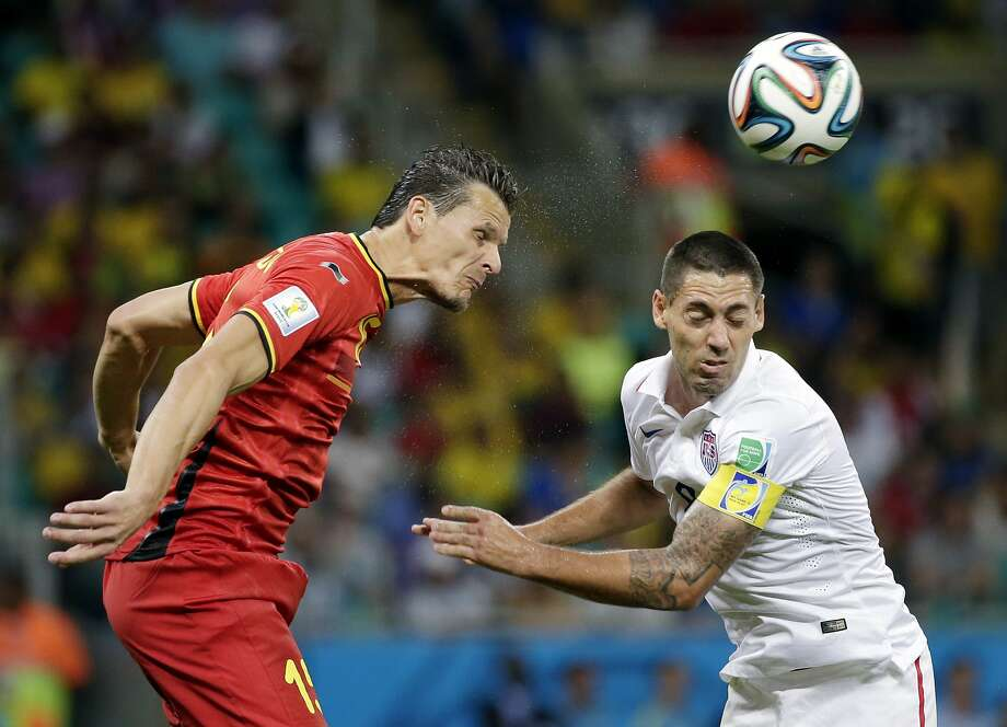 United States' Clint Dempsey, right, and Belgium's Daniel Van Buyten, left, go for a header during the World Cup round of 16 soccer match between Belgium and the USA at the Arena Fonte Nova in Salvador, Brazil, Tuesday, July 1, 2014. (AP Photo/Felipe Dana) Photo: Felipe Dana, Associated Press