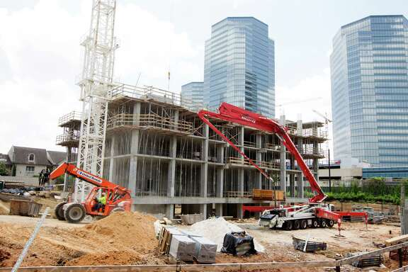 Belfiore, a condominium tower, is under construction near the Galleria. Townhouse and condo sales are up in Houston.