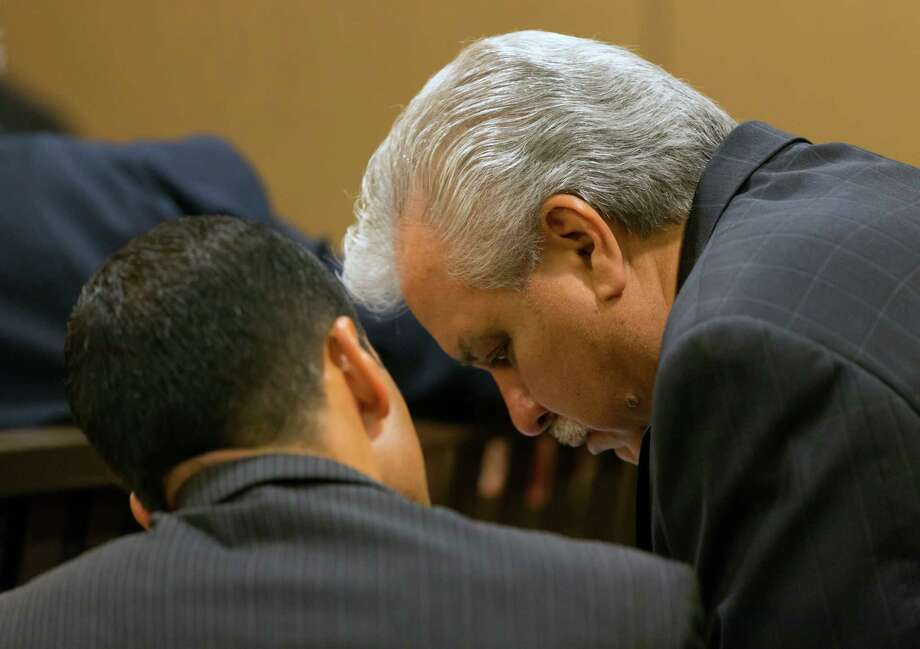 Gary Cain, who is facing four felony counts for allegedly defrauding Rackspace Hosting Inc. in a deal involving property for its Windcrest headquarters, talks Tuesday July 1, 2014 with one of his lawyers before his trial starts. Photo: William Luther, San Antonio Express-News / © 2014 San Antonio Express-News