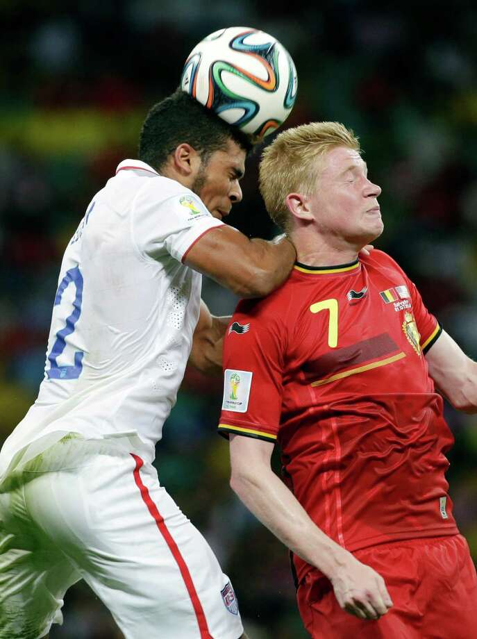 United States' DeAndre Yedlin, left, and Belgium's Kevin De Bruyne (7) go for a header during the World Cup round of 16 soccer match between Belgium and the USA at the Arena Fonte Nova in Salvador, Brazil, Tuesday, July 1, 2014. (AP Photo/Felipe Dana) Photo: Felipe Dana, Associated Press / AP