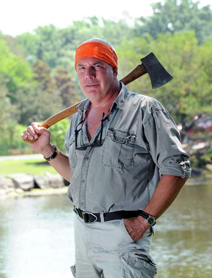 """With axe on shoulder, Steve Lancia, owner of Northcamp, a wilderness and outdoor survival skills camp, at Bruce Park, Greenwich, Conn., Tuesday, July 1, 2014. Lancia's first rule for surviving a wilderness situation is to """"stay calm!"""" Photo: Bob Luckey / Greenwich Time"""