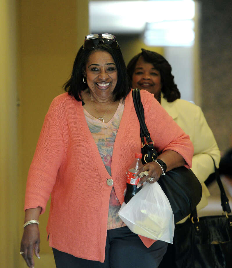 "Cybil Comeaux heads into Judge Tom Rugg's courtroom after lunch Tuesday. Ron Reynolds' case against the Beaumont Independent School District continued in state District Judge Tom Rugg's courtroom Tuesday. Reynolds alleges that his inclusion on the district's reduction-in-force list is a matter of retaliation against a ""threat to the central power of the district."" Photo taken Tuesday 7/1/14 Jake Daniels/@JakeD_in_SETX Photo: Jake Daniels / ©2014 The Beaumont Enterprise/Jake Daniels"
