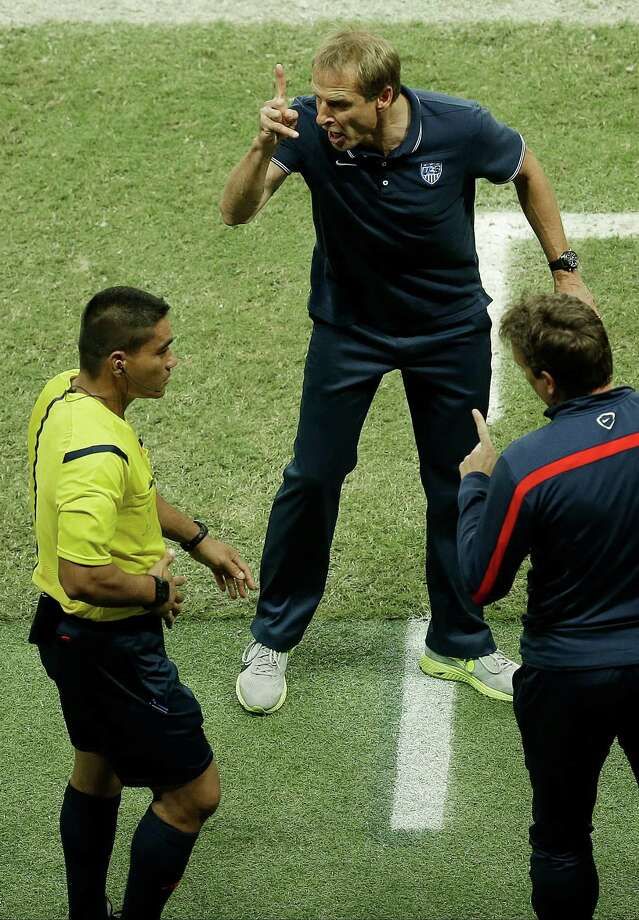 United States' head coach Juergen Klinsmann argues with the fourth official Norbert Hauata during the World Cup round of 16 soccer match between Belgium and the USA at the Arena Fonte Nova in Salvador, Brazil, Tuesday, July 1, 2014. (AP Photo/Themba Hadebe) Photo: Themba Hadebe, Associated Press / AP