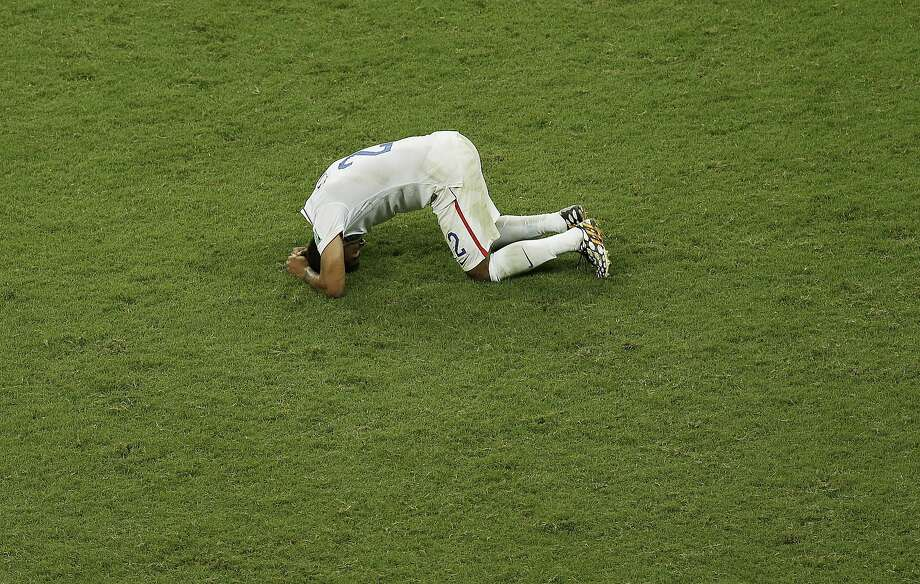 United States' DeAndre Yedlin rests on the pitch after the United States lost 1-2 against Belgium after extra time of the World Cup round of 16 soccer match between Belgium and the USA at the Arena Fonte Nova in Salvador, Brazil, Tuesday, July 1, 2014. (AP Photo/Themba Hadebe) Photo: Themba Hadebe, Associated Press