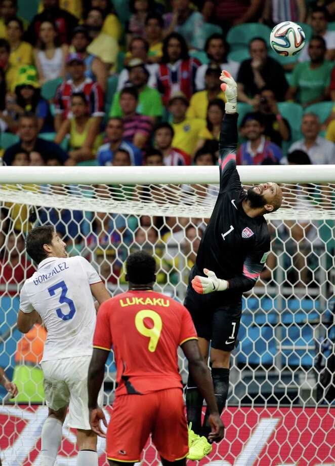 United States' goalkeeper Tim Howard (1) saves a shot during the World Cup round of 16 soccer match between Belgium and the USA at the Arena Fonte Nova in Salvador, Brazil, Tuesday, July 1, 2014. (AP Photo/Felipe Dana) Photo: Felipe Dana, Associated Press / AP