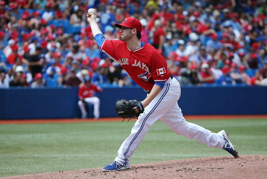 TORONTO, CANADA - JULY 1: Drew Hutchison #36 of the Toronto Blue Jays delivers a pitch in the third inning during MLB game action against the Milwaukee Brewers on July 1, 2014 at Rogers Centre in Toronto, Ontario, Canada. (Photo by Tom Szczerbowski/Getty Images) Photo: Tom Szczerbowski, Getty Images