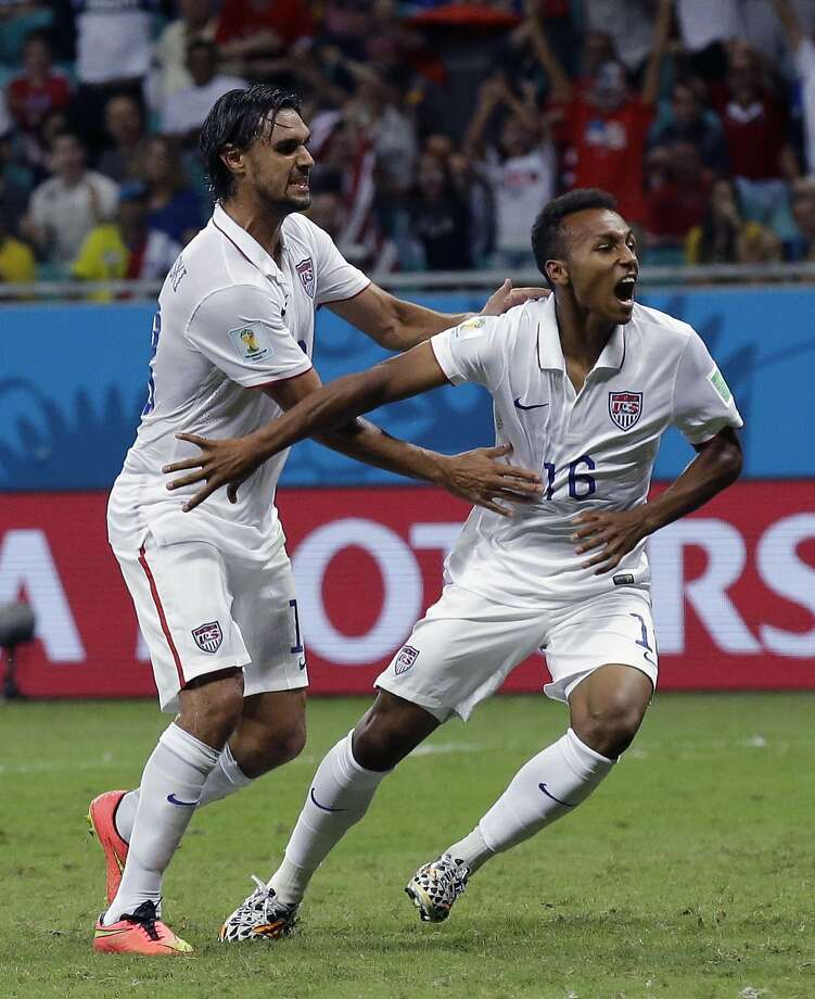 United States' Julian Green, right, celebrates after scoring his side's first goal during the World Cup round of 16 soccer match between Belgium and the USA at the Arena Fonte Nova in Salvador, Brazil, Tuesday, July 1, 2014. (AP Photo/Matt Dunham) Photo: Matt Dunham, Associated Press