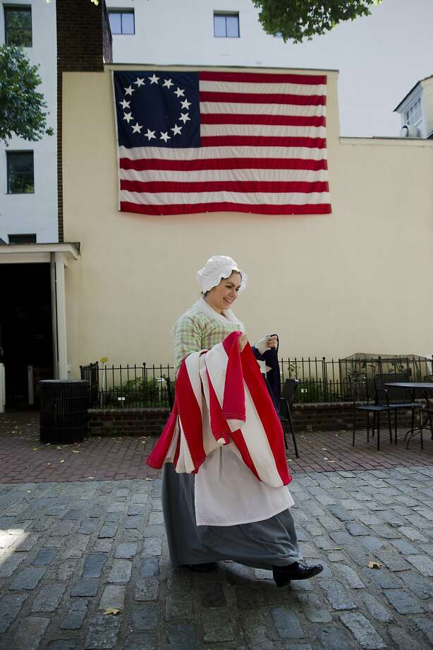 A thimble of democracy:Jess Brownell portrays Betsy Ross, America's greatest sewer, er,   seamstress, during a flag-raising ceremony at the Ross House in Philadelphia. Photo: Matt Rourke, Associated Press