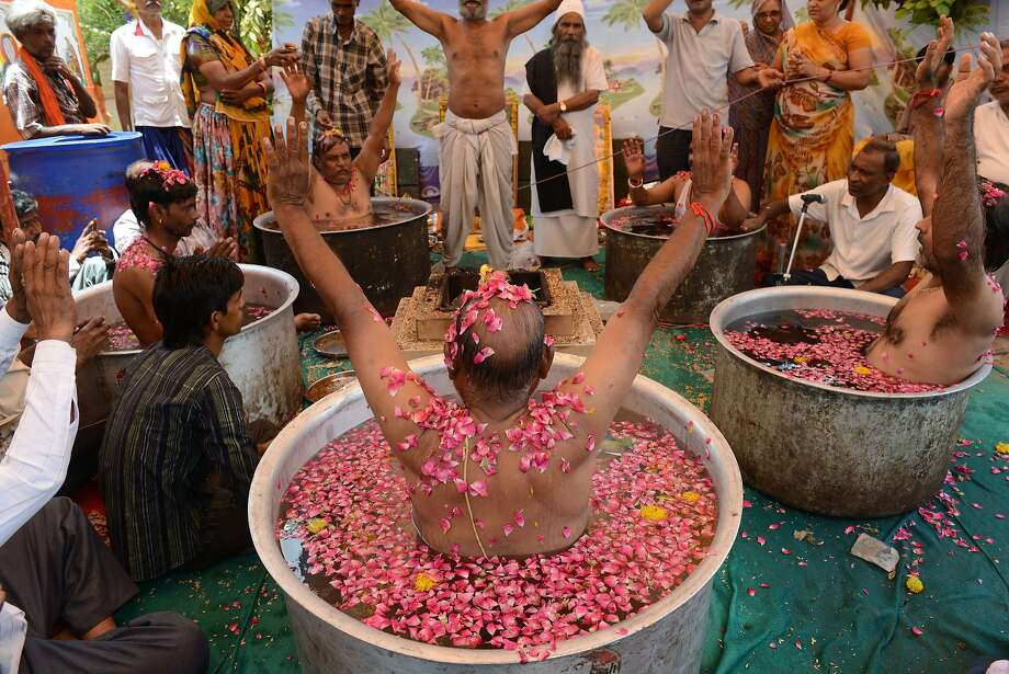 Top Brahmin soup:Hindu Brahmins perform the soaking-in-a-tub ritual to appease the rain god   on the outskirts of Ahmedabad. Many regions of India fear that this monsoon season will not   bring enough rain. Photo: Sam Panthaky, AFP/Getty Images