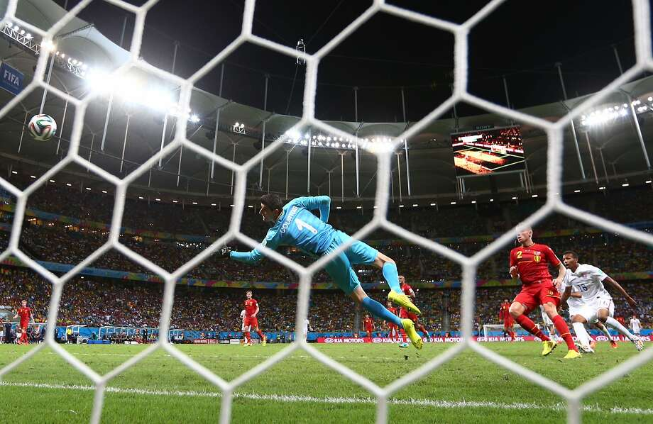 SALVADOR, BRAZIL - JULY 01:  Julian Green of the United States scores his team's first goal past Thibaut Courtois of Belgium in extra time during the 2014 FIFA World Cup Brazil Round of 16 match between Belgium and the United States at Arena Fonte Nova on July 1, 2014 in Salvador, Brazil.  (Photo by Michael Steele/Getty Images) Photo: Michael Steele, Getty Images