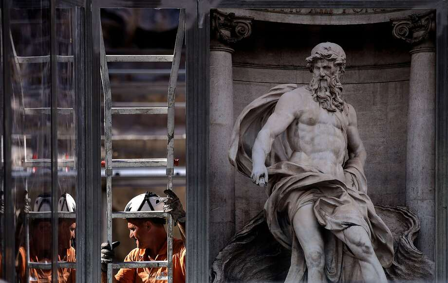 Neptune gets a face-lift: A worker sets up a ladder during the restoration of the famous Trevi fountain in Rome. Photo: Filippo Monteforte, AFP/Getty Images