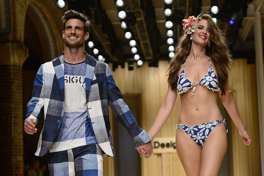 She's underdressed, he's over the top:Models present creations by Desigual during 080 Barcelona Spring-Summer 2015 fashion week. Photo: Josep Lago, AFP/Getty Images
