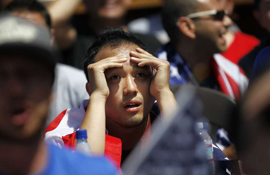 Jingsong Wang, like many other Americans, watched the U.S. take on Belgium, hoping for nothing but glory. Photo: Leah Millis, The Chronicle