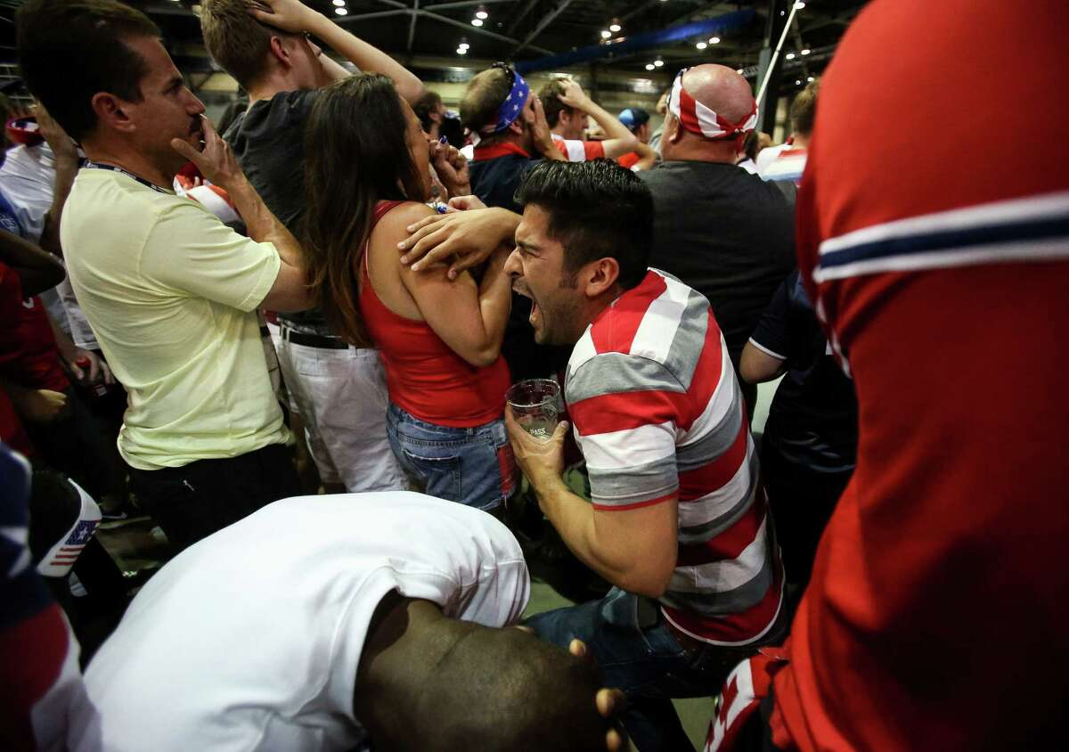 Marcus Costello (center), 27, reacts after a narrow miss by the United States in the final seconds of regulation. Thousands gathered in CenturyLink Events Center to watch the United States play Belgium on Tuesday, July 1, 2014. USA lost to Belgium, 2-1.