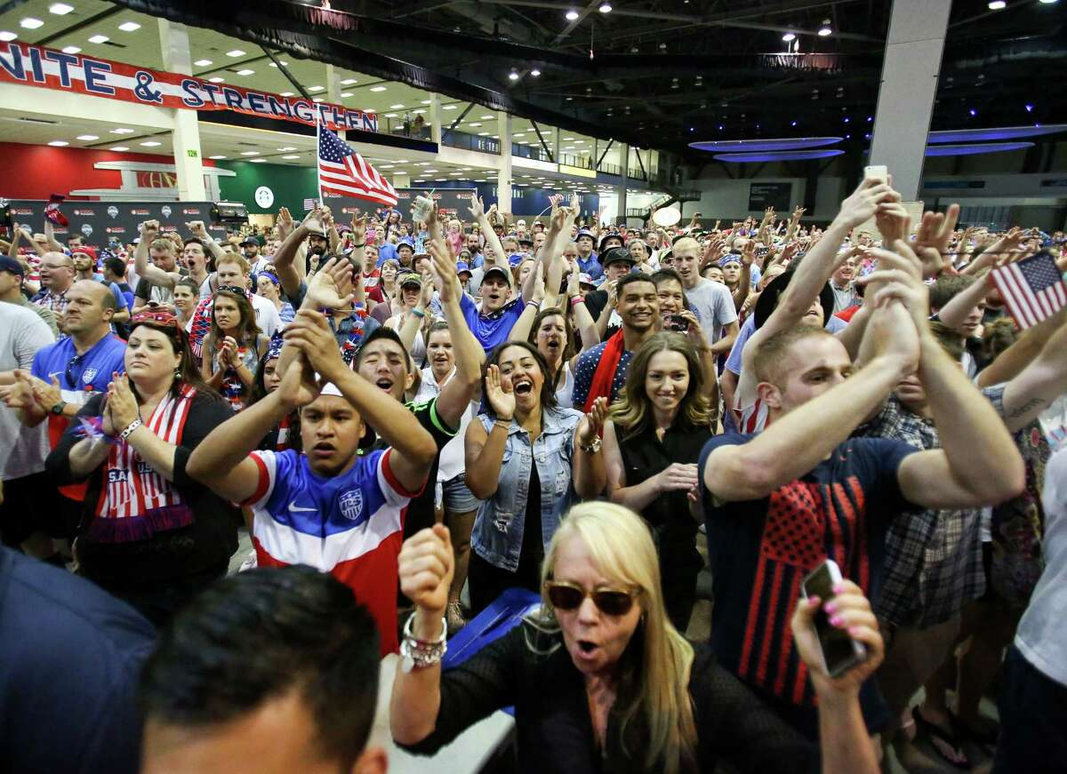 Fans react while watch the United States play Belgium in the World Cup. Thousands gathered in CenturyLink Events Center to watch the United States play Belgium on Tuesday, July 1, 2014. USA lost to Belgium, 2-1.