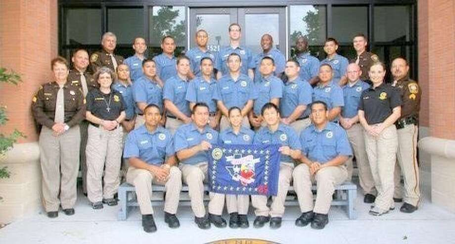 Graduates and instructors for the 29th Class and staff of the Gus George Law Enforcement Academy include: Vinod Kurian, Edgar Itzep, Angela Pedraza, Tuan-Huy Tran and Andres Reyes. Second row: Sgt. Judy Cervenka, Sgt. Casey Schmidt, Cyndi Villemaire, Samuel Originales, Ricardo Guzman, Michael Smith, Jon Lopez, Luke Kothmann, Bernardo Gonzales, Eric Dixon, Anthony Zavala, Cody Jensen, Dottie Allen and Sgt. Carlos Castillo. Third row: Lt. Jim Pokluda, Travis Younger, Alexander Rey, Christopher McCarty, Jonathan Smith, Terrence Greene, Corey Swiney, Jesus Trevino and Capt. Matt Carter. Photo: Fort Bend County Sheriff's Office