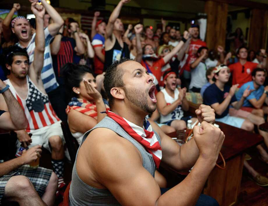 Ramon Bentley, of Stamford, roots for the United States during the World Cup match against Belgium Tuesday, July 1, 2014, at Anna Liffey's in Fairfield, Conn. Photo: Autumn Driscoll / Connecticut Post