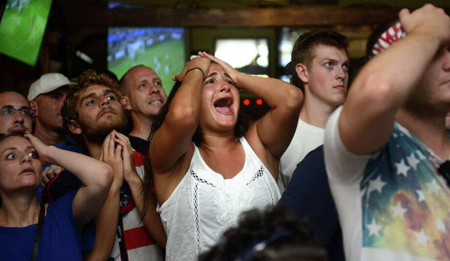 Melissa Montonaro, of Shelton, watches the World Cup match between the United States and Belgium Tuesday, July 1, 2014, at Anna Liffey's in Fairfield, Conn. Photo: Autumn Driscoll / Connecticut Post