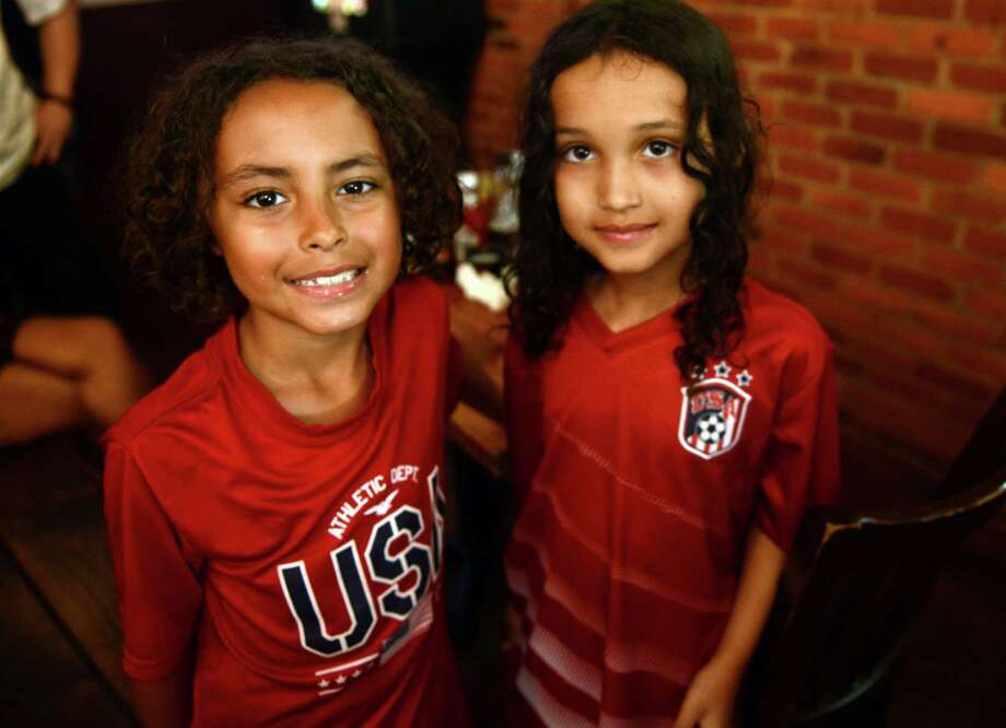 Soccer fans root for the United States during the World Cup match against Belgium Tuesday, July 1, 2014, at Anna Liffey's in Fairfield, Conn. Photo: Autumn Driscoll / Connecticut Post