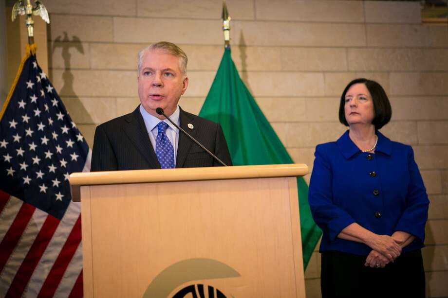 Mayor Ed Murray, accompanied by Seattle Police Chief Kathleet O'Toole in this file photo, announced a raft of police accountability reforms Wednesday, including the permanent establishment of a civilian Community Police Commission. (seattlepi.com file photo) Photo: JOSHUA TRUJILLO, SEATTLEPI.COM