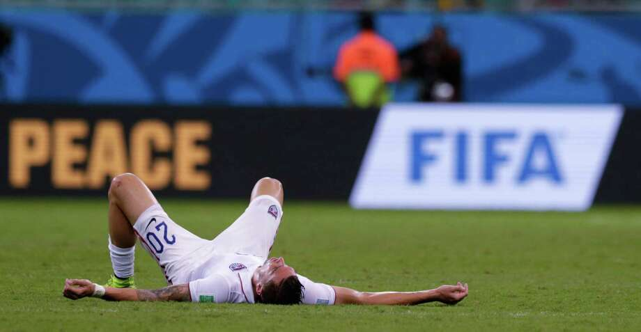 United States' Geoff Cameron lays on the pitch after the World Cup round of 16 soccer match between Belgium and the USA at the Arena Fonte Nova in Salvador, Brazil, Tuesday, July 1, 2014. Belgium won the match 2-1 after extra-time.  (AP Photo/Julio Cortez) Photo: Julio Cortez, STF / AP