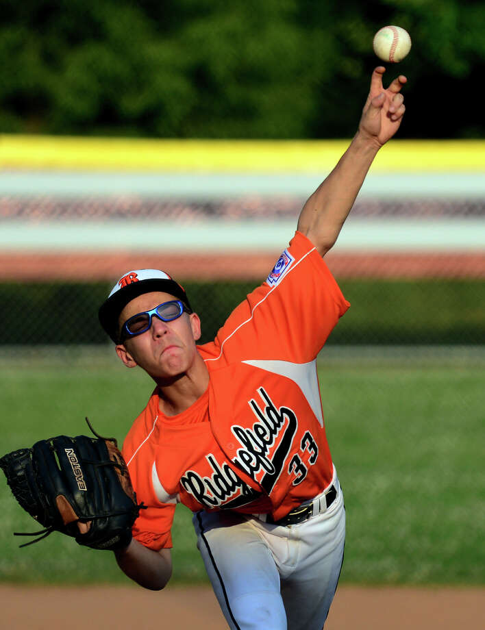 Ridgefield's Matthew Restivo pitches against North Stamford, during little league baseball action at Scribner Park in Weston, Conn. on Tuesday July 1, 2014. Photo: Christian Abraham / Connecticut Post
