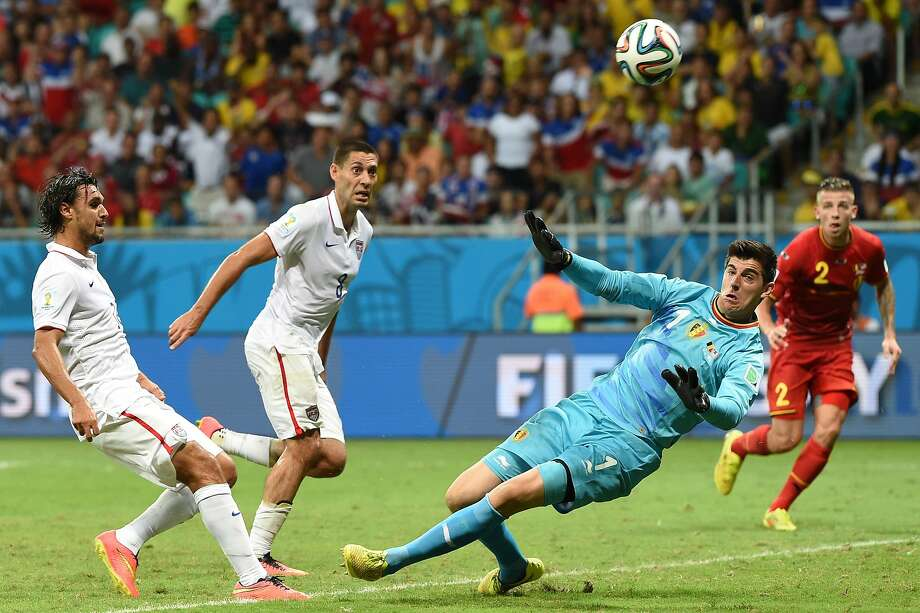 US forward Chris Wondolowski (L) shoots past Belgium's goalkeeper Thibaut Courtois during a Round of 16 football match between Belgium and USA at Fonte Nova Arena in Salvador during the 2014 FIFA World Cup on July 1, 2014.      AFP PHOTO/ FRANCISCO LEONGFRANCISCO LEONG/AFP/Getty Images Photo: Francisco Leong, AFP/Getty Images