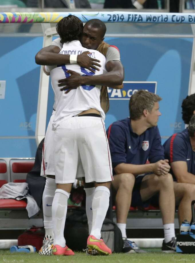 United States' Jozy Altidore embraces Chris Wondolowski before a substitution during the World Cup round of 16 soccer match between Belgium and the USA at the Arena Fonte Nova in Salvador, Brazil, Tuesday, July 1, 2014. (AP Photo/Julio Cortez) Photo: Julio Cortez, Associated Press