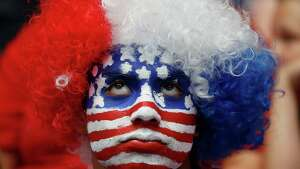 Tommy Martinez, of Midlothian, looks toward the video board late in regulation time during a watch party for the World Cup soccer match between the United States and Belgium in Arlington, Texas, Tuesday, July 1, 2014. (AP Photo/The Dallas Morning News, Andy Jacobsohn)