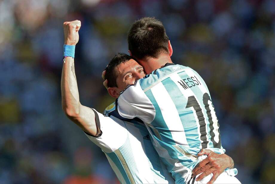Argentina's Lionel Messi celebrates with Angel di Maria after di Maria scored his side's only and winning goal in extra time during the World Cup round of 16 soccer match between Argentina and Switzerland at the Itaquerao Stadium in Sao Paulo, Brazil, Tuesday, July 1, 2014. Argentina defeated Switzerland 1-0 to move on to the quarterfinals. (AP Photo/Manu Fernandez) ORG XMIT: WCDP195 Photo: Manu Fernandez / AP
