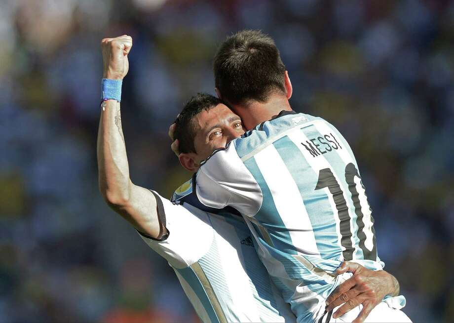 Argentina's Lionel Messi celebrates with Angel Di Maria after the latter scored his side's winning goal in extra time. Photo: Manu Fernandez / Associated Press / AP