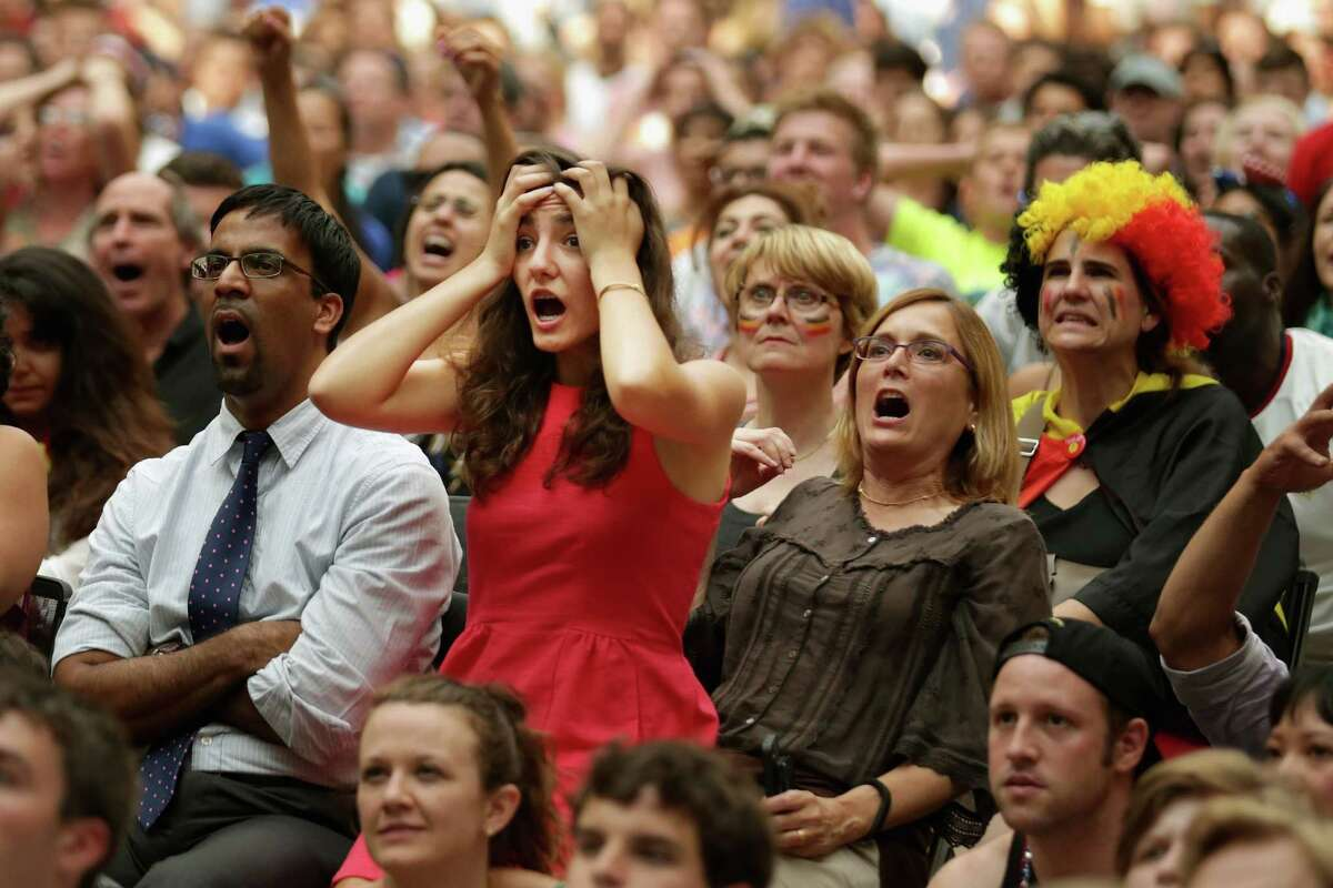 Some of an estimated 1,000 people gather to watch the World Cup soccer match between Belgium and the United States in the Kogod Courtyard of the Smithsonian National Portait Gallery July 1, 2014 in Washington, United States. Belgium won the match 2-1.