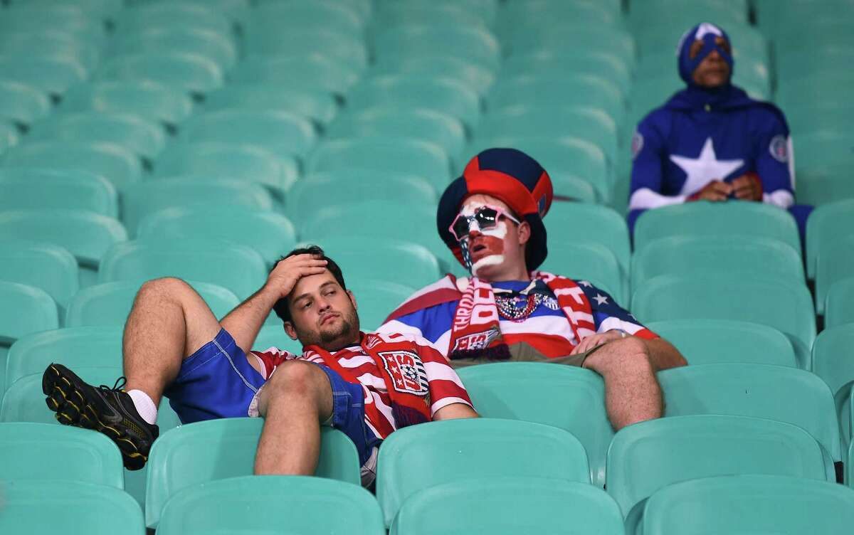 Dejected United States fans look on after being defeated by Belgium 2-1 in extra time during the 2014 FIFA World Cup Brazil Round of 16 match between Belgium and the United States at Arena Fonte Nova on July 1, 2014 in Salvador, Brazil.