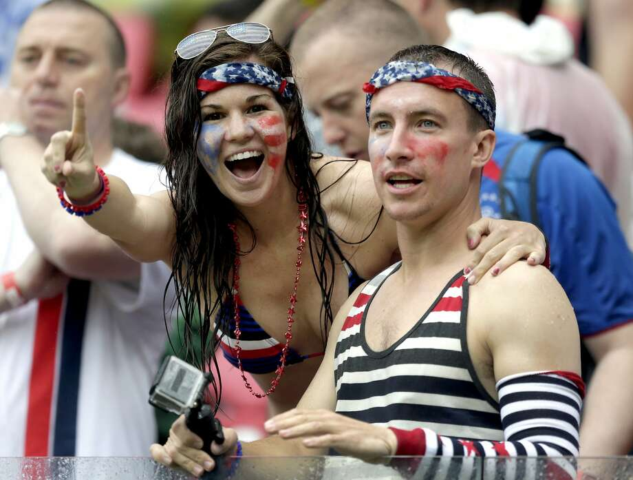 USA supporters cheer their national team during the group G World Cup soccer match between the United States and Germany at the Arena Pernambuco in Recife, Brazil, Thursday, June 26, 2014. (AP Photo/Julio Cortez) Photo: Julio Cortez, Associated Press