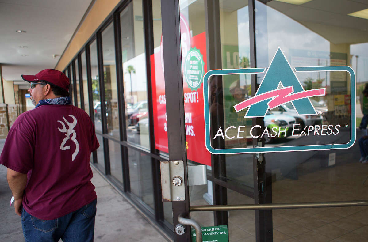 A man leaves an Ace Cash Express near Crosstim-bers and Fulton on Tuesday. A worker at one lender said the impact of the ordinance was clear.