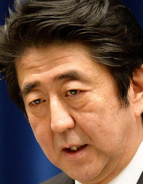 Prime Minister Shinzo Abe says his government is reinterpreting the nation's anti-war constitution. / AFP