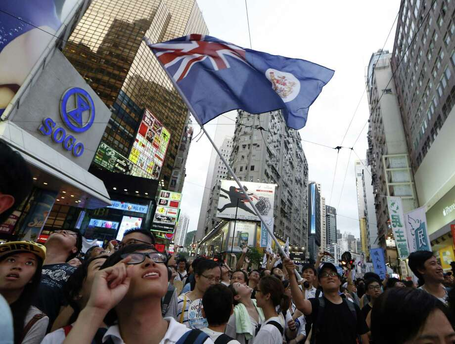 Organizers of Tuesday's event in Hong Kong says much larger demonstrations will occur if Beijing refuses to allow free elections in the former British colony. Photo: Kin Cheung / Associated Press / AP