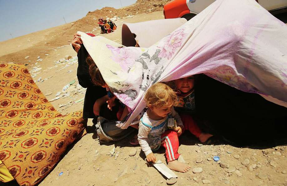 A displacement camp in Khazair, Iraq, is home to an estimated 1,500 people who have fled cities overrun by ISIS (Islamic State of Iraq and Syria) militants. Photo: Spencer Platt / Getty Images / 2014 Getty Images